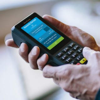 Verifone Commerce-Enabled Device in hand