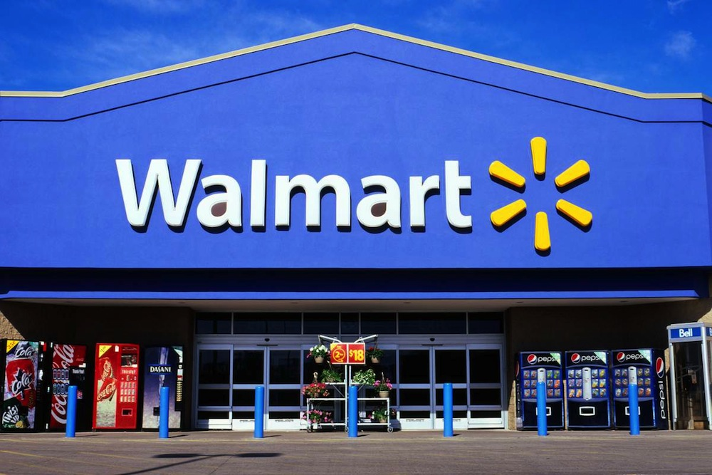 Wal-Mart drops Stores from name to shed brick and mortar image