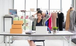 small fashion retailer at desk