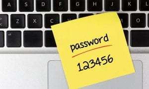 password sticky note on keyboard
