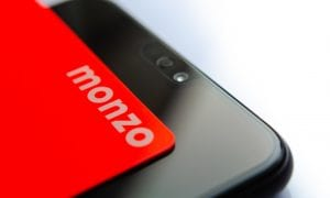 Monzo bank card and smartphone