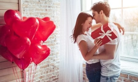 couple with heart balloons