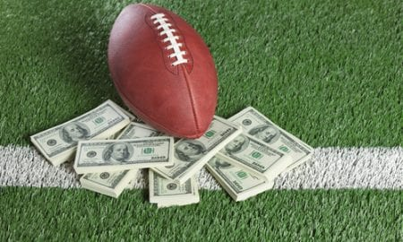 football with cash stacks
