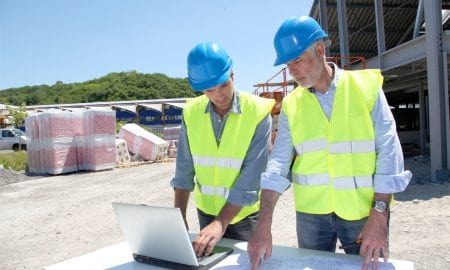 construction workers with laptop