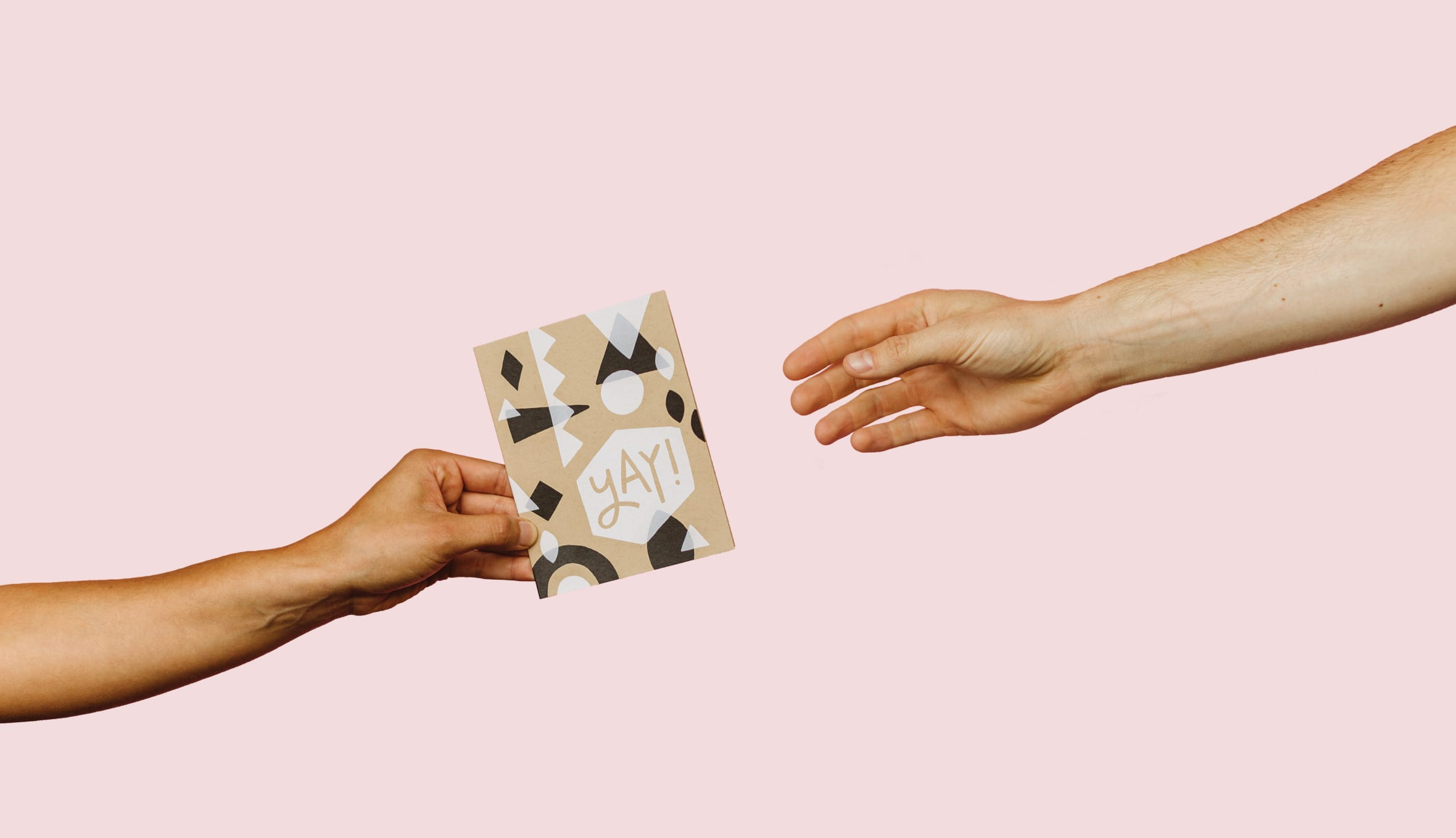 hands with greeting card