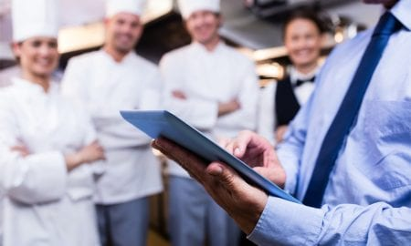 restaurant manager with staff
