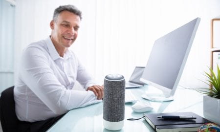 man talking to voice assistant