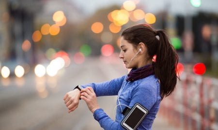 runner with watch and smartphone