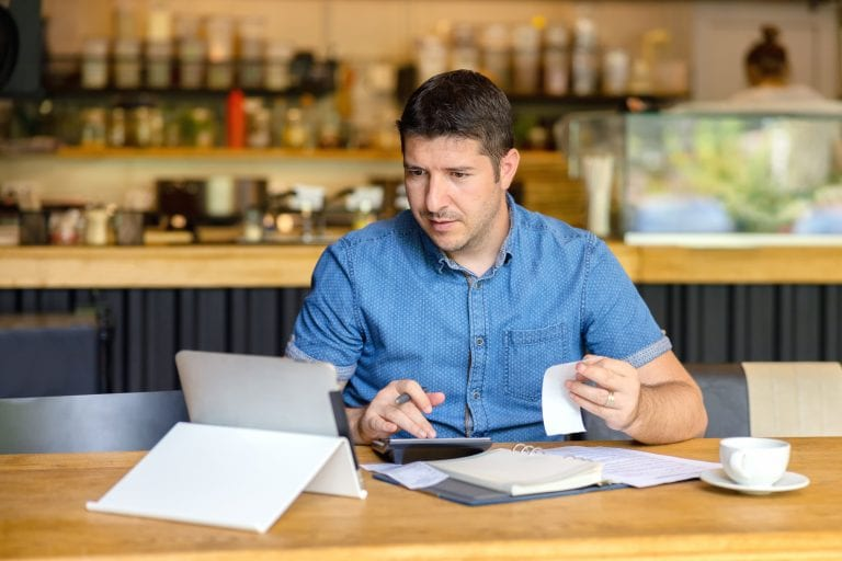 small business owner with bills