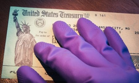 gloved hand on Treasury check