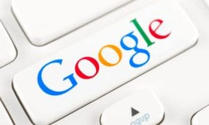 Google slashes marketing budget by half