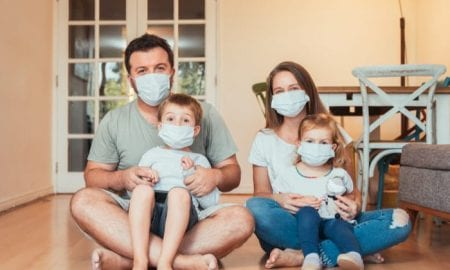 family with face masks