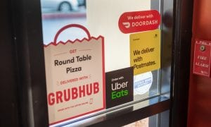 Grubhub, Uber Eats sign