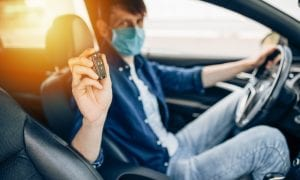 pandemic car buyer with mask