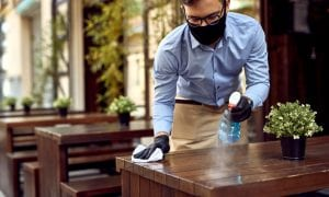 waiter in mask cleaning table