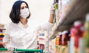 woman in face mask shopping