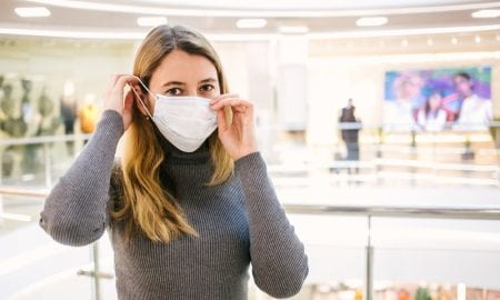 woman in store with mask