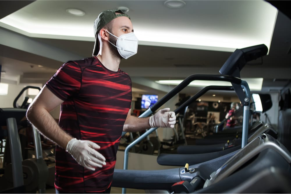 man in gym with face mask
