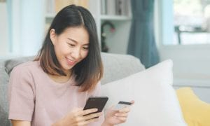 woman online shopping with smartphone